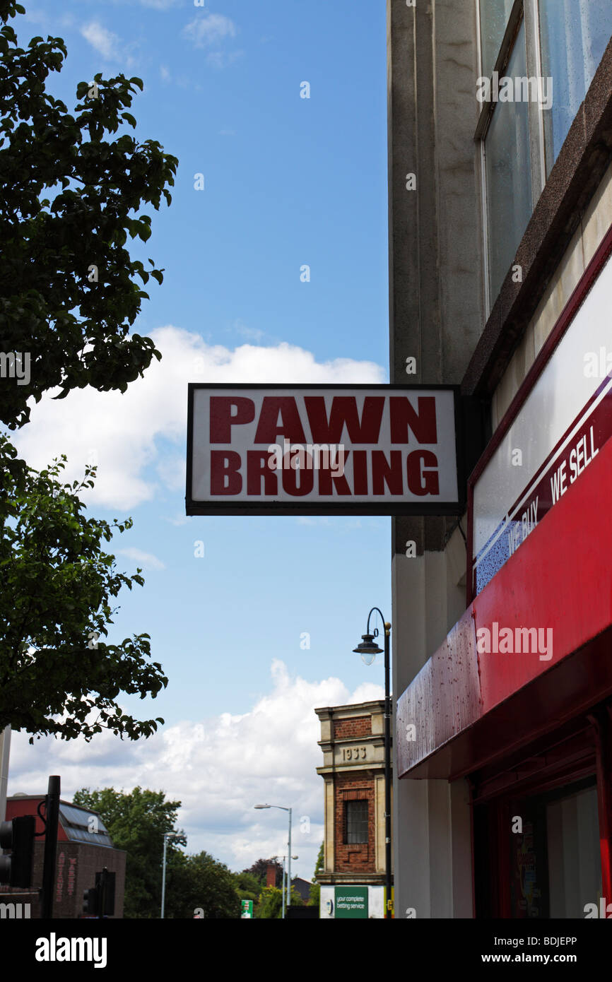 Pawn broking sign outside a high street money lenders - Stock Image