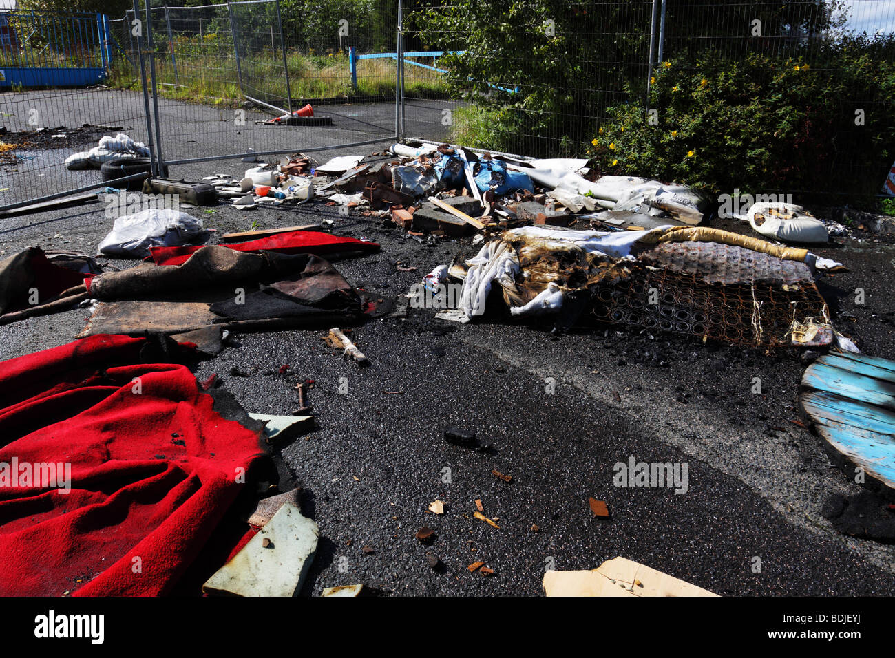 Rubbish illegally dumped on urban waste ground near Wolverhampton city centre - Stock Image