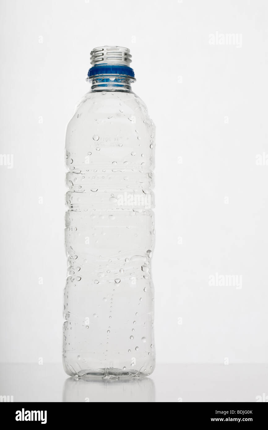 Empty small clear plastic mineral water bottle - Stock Image
