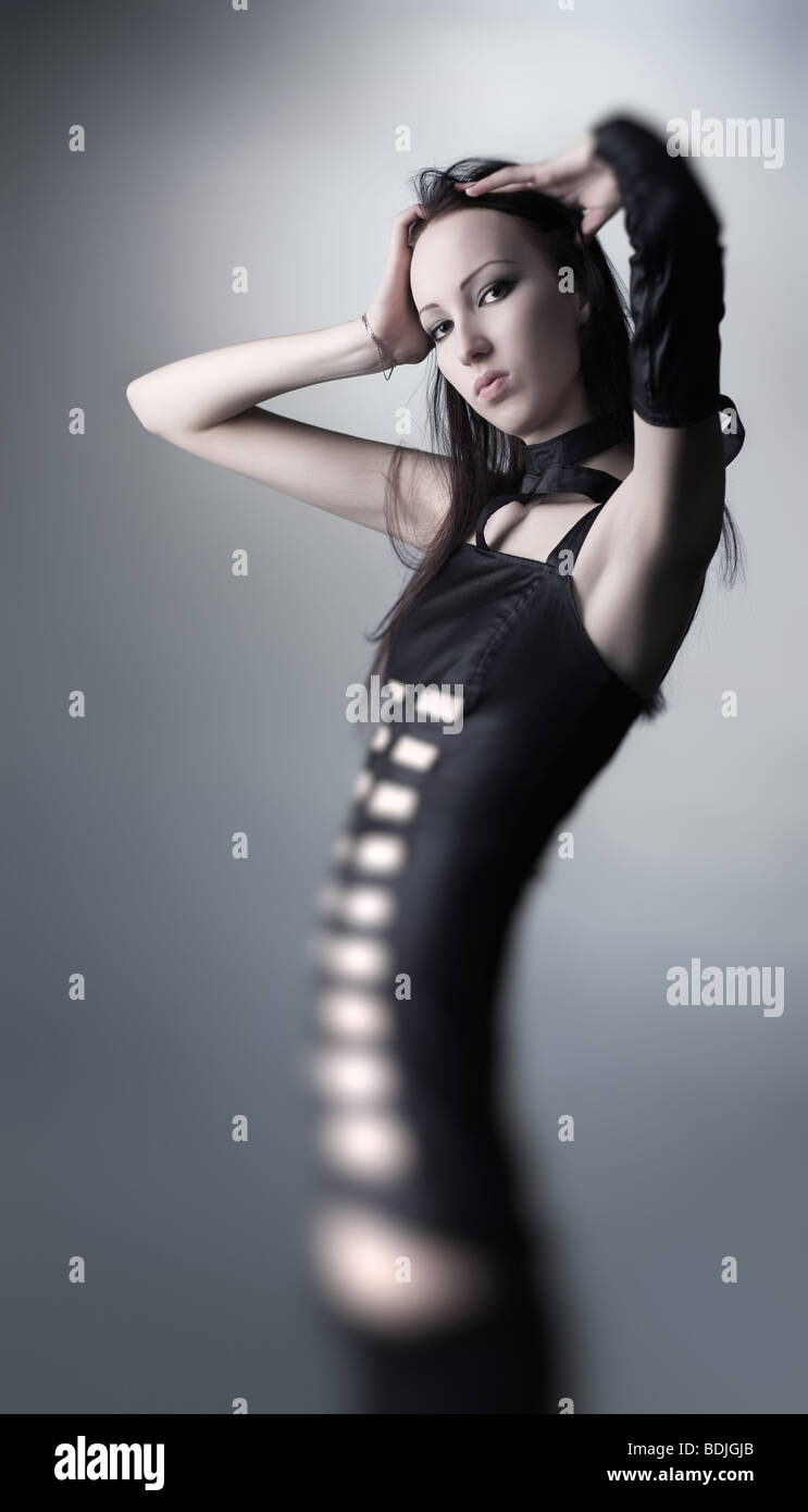 Goth woman. Abstract fantasy with very slim body. - Stock Image