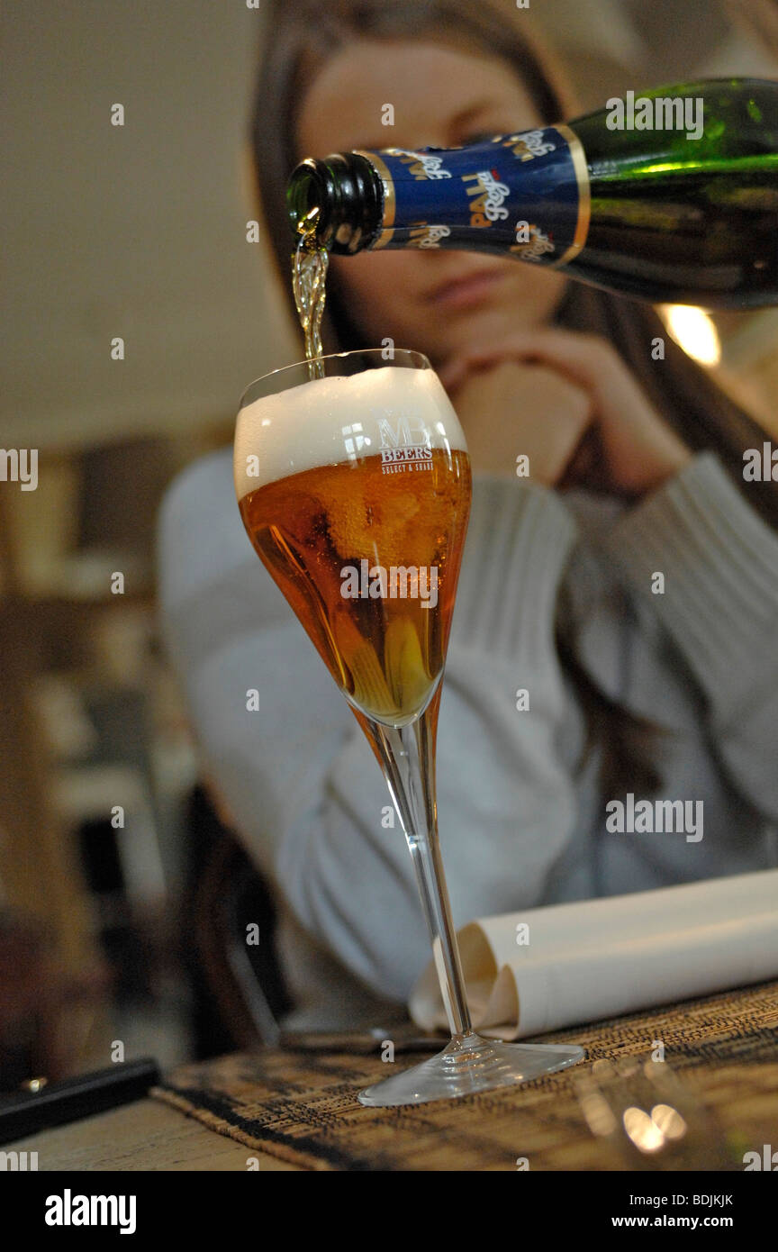 Pouring glass of Palm Royale Belgian beer. - Stock Image