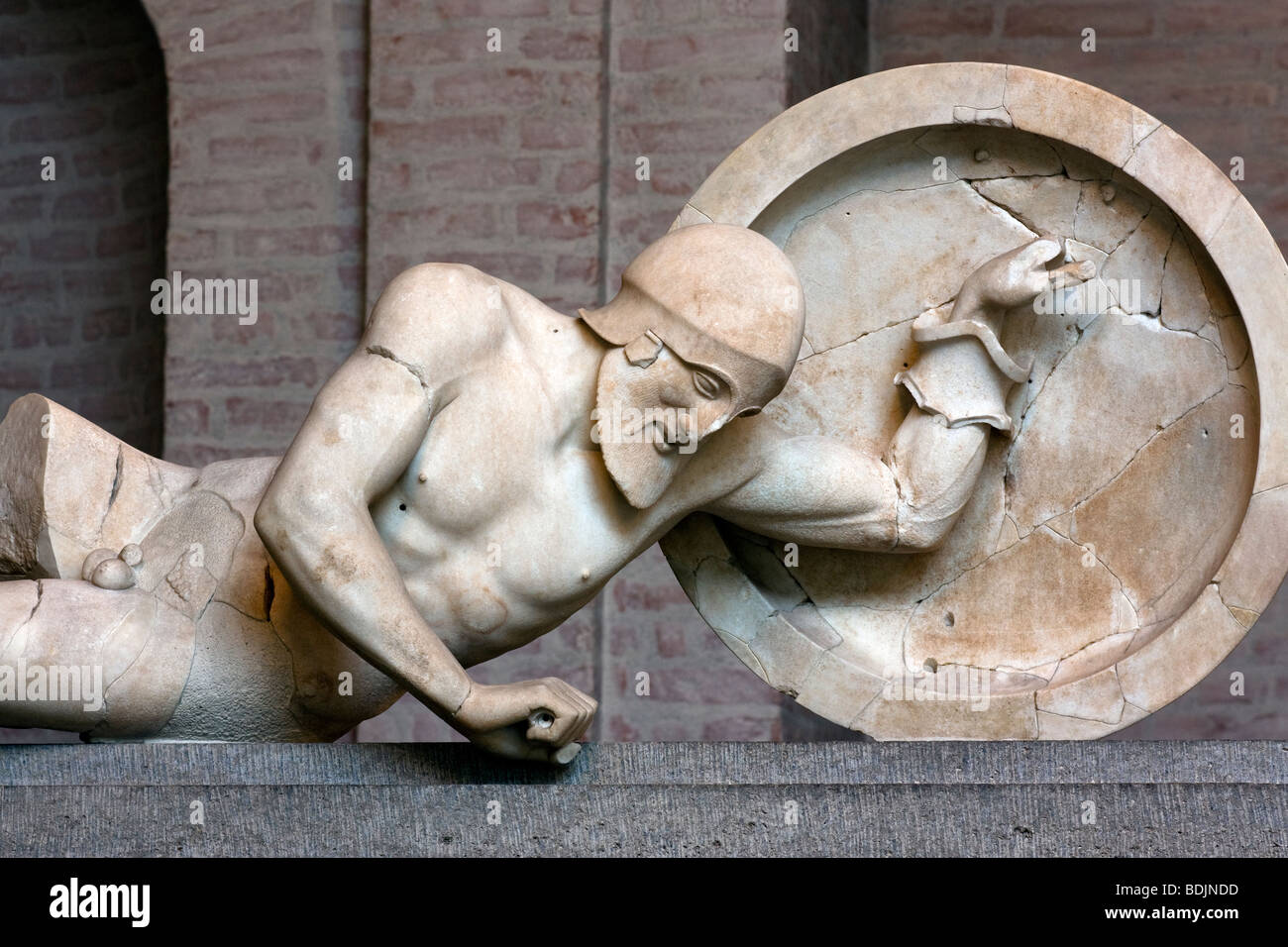 Dying warrior from the east pediment of the Temple of Aphaia at Aegina, now displayed in the Munich Glyptothek. - Stock Image