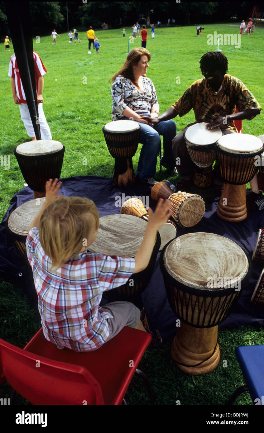 Young Child Learning How To Play Bongo Drums At An Organised