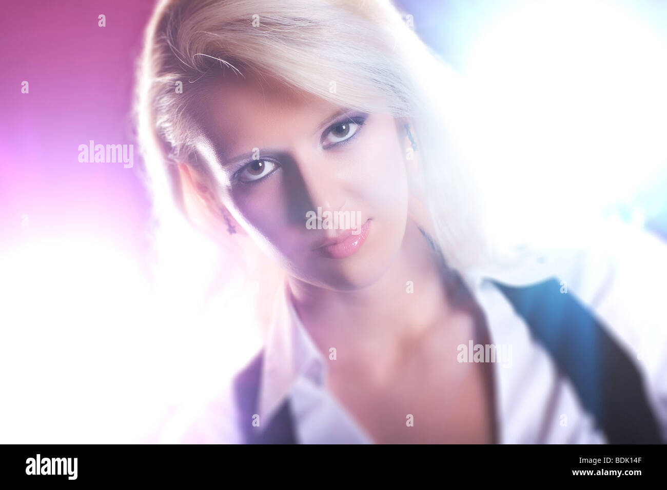 Young woman portrait with bright flashes. - Stock Image