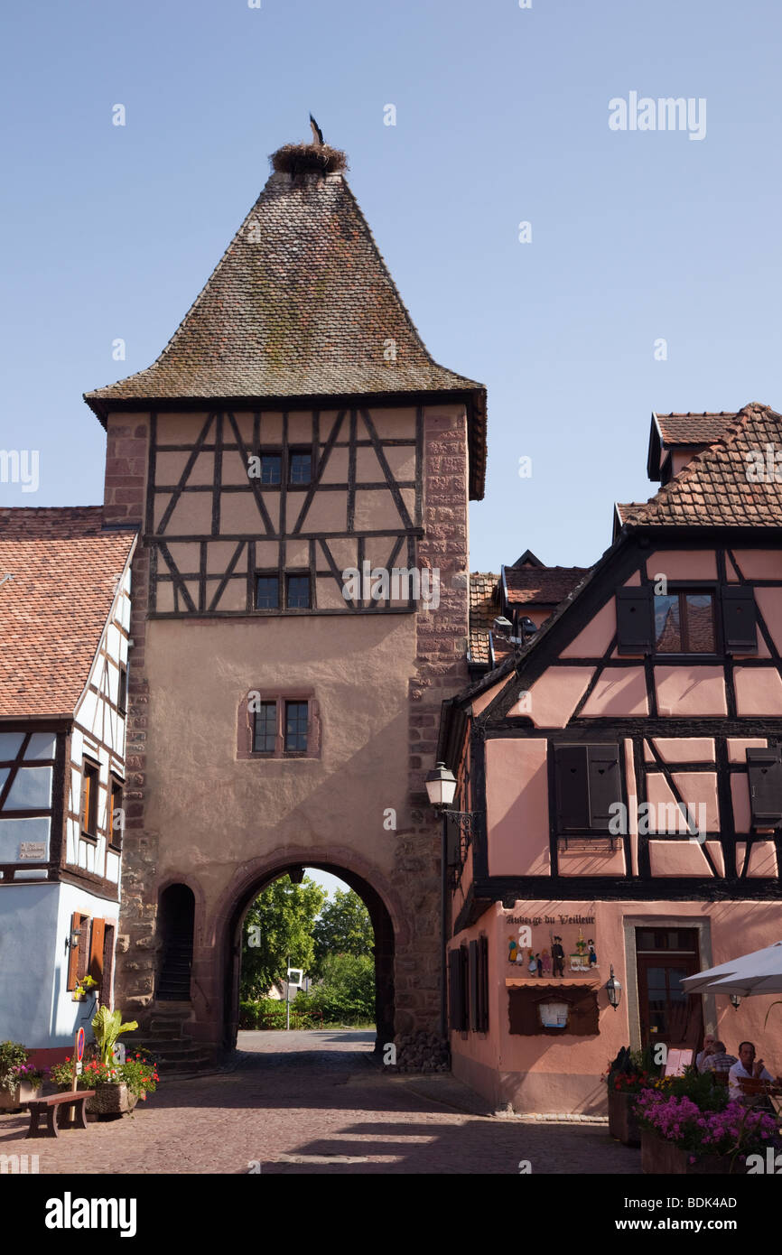 Turckheim Alsace France Europe. Gateway tower and historic buildings in picturesque fortified medieval village on - Stock Image