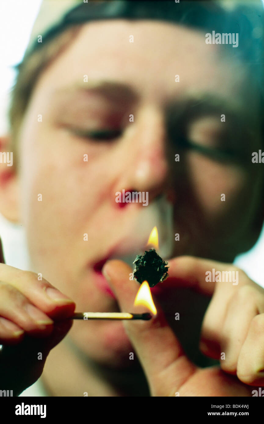 Teenage boy smoking marijuana - Stock Image