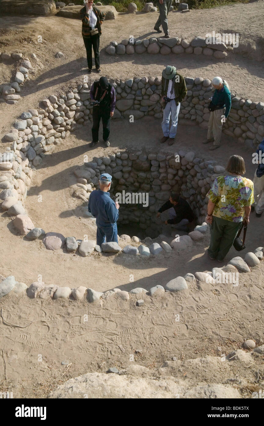 Travelers watching ancient ruins in Ica, Peru - Stock Image