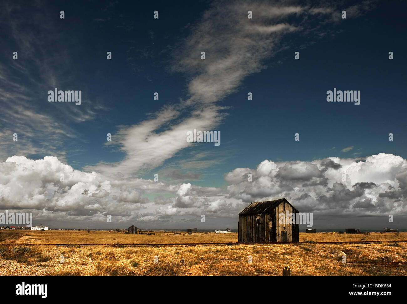 An abandoned fishermans wooden hut at Dungeness in Kent. - Stock Image