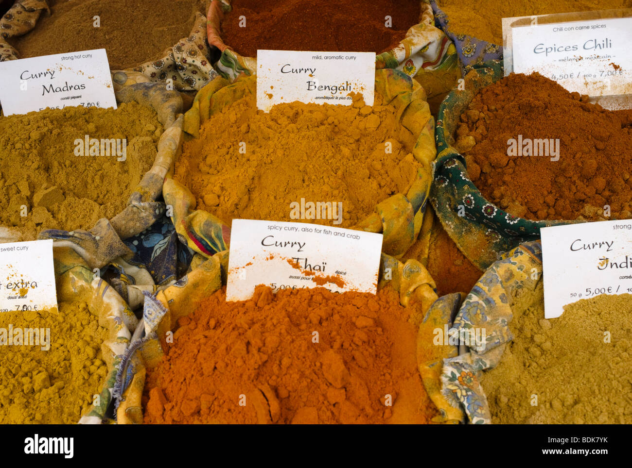 Spices for sale in a French country market - Stock Image