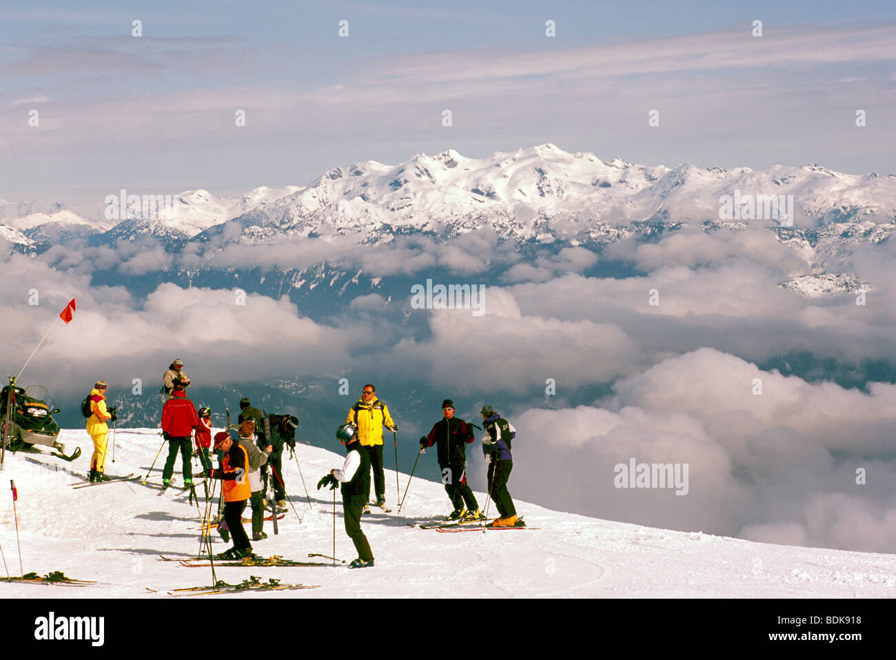 Group of Skiers downhill skiing on Blackcomb Mountain at Whistler Ski Resort in the 'Coast Mountains' of - Stock Image