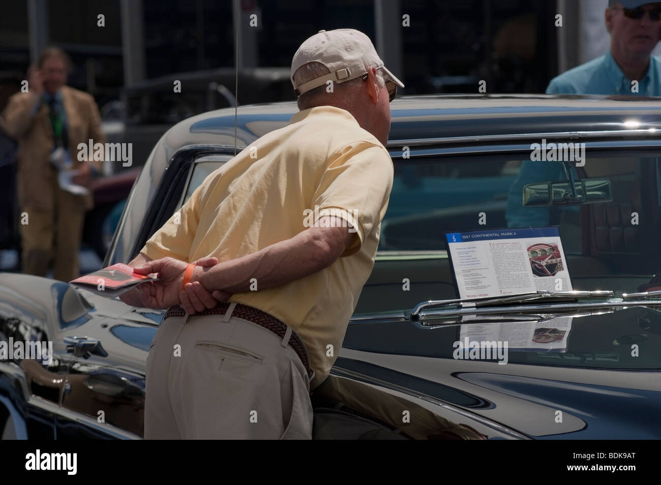 Bidder inspecting a 1957 Continental Mark II in the Gooding & Company tent at the 2009 Pebble Beach Concours - Stock Image