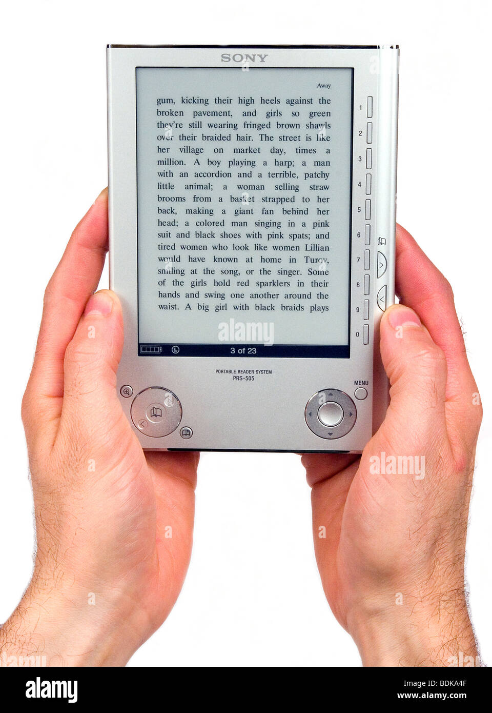 Hands holding Sony Reader, a digital electronic portable book storage and reading device - Stock Image