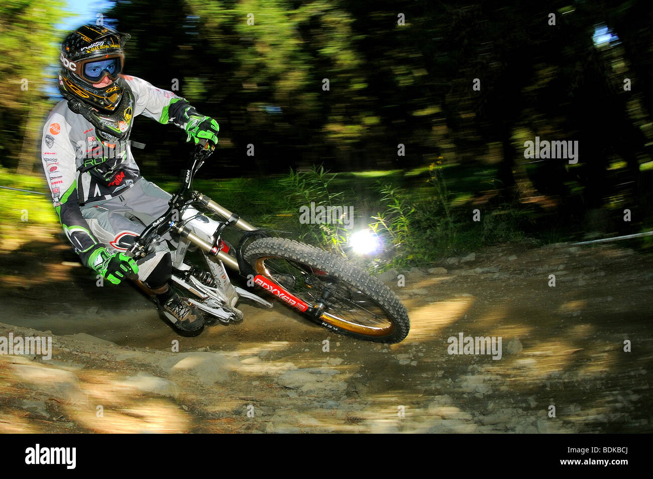 A Downhill Mountain Biker Rides At Speed In A Full Face Helmet And
