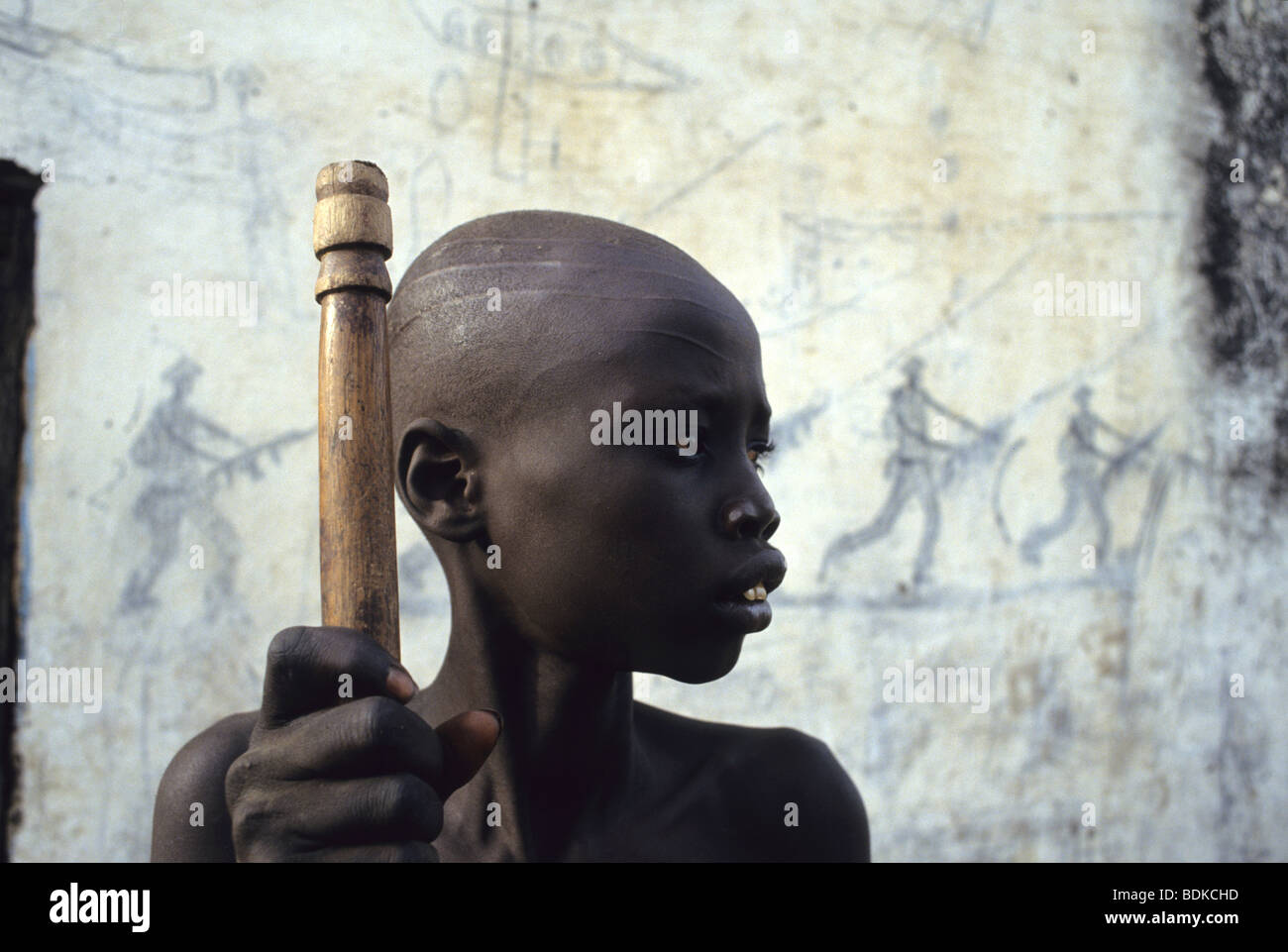 A Dinka boy barely able to stand due to starvation - Stock Image