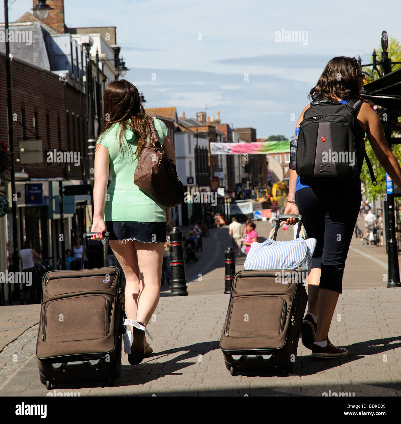Two Young Girls Travelling Bags Stock Photos   Two Young Girls ... 909099581c8d1