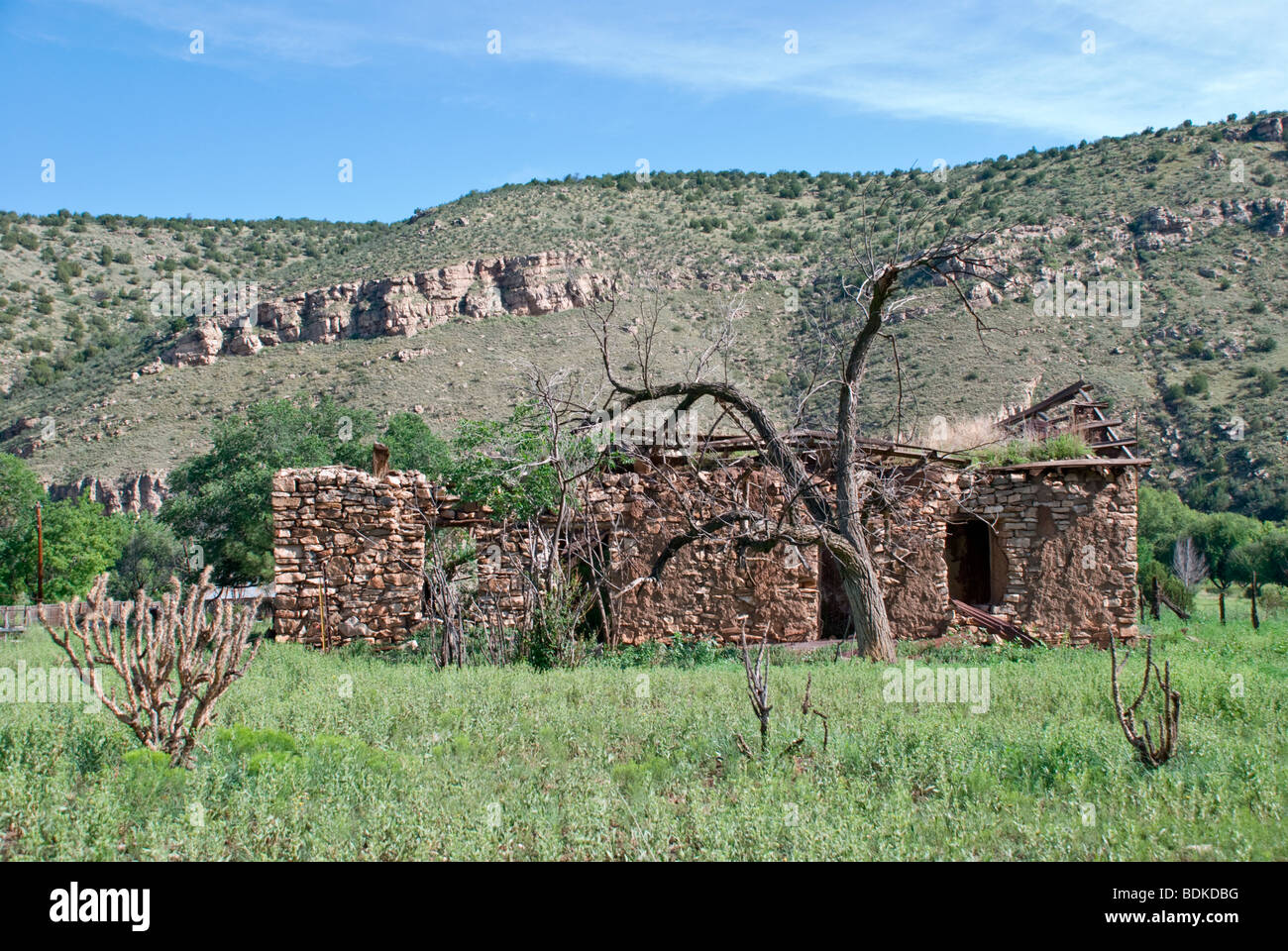 Old abandoned stone and adobe house in the Bonito River Valley, near historic Lincoln, New Mexico. - Stock Image