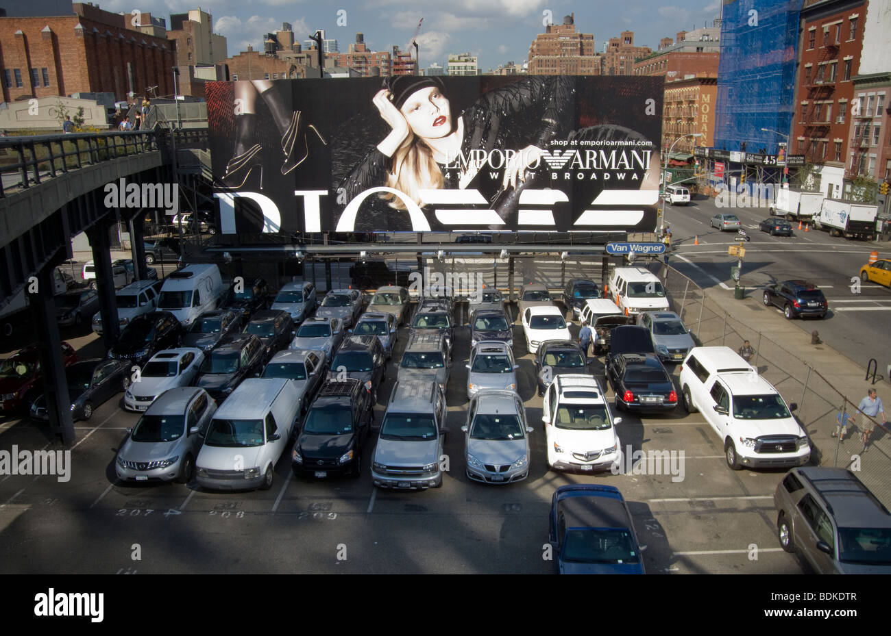 A billboard for Emporio Armani is seen from the new High Line Park in the New York neighborhood of Chelsea - Stock Image