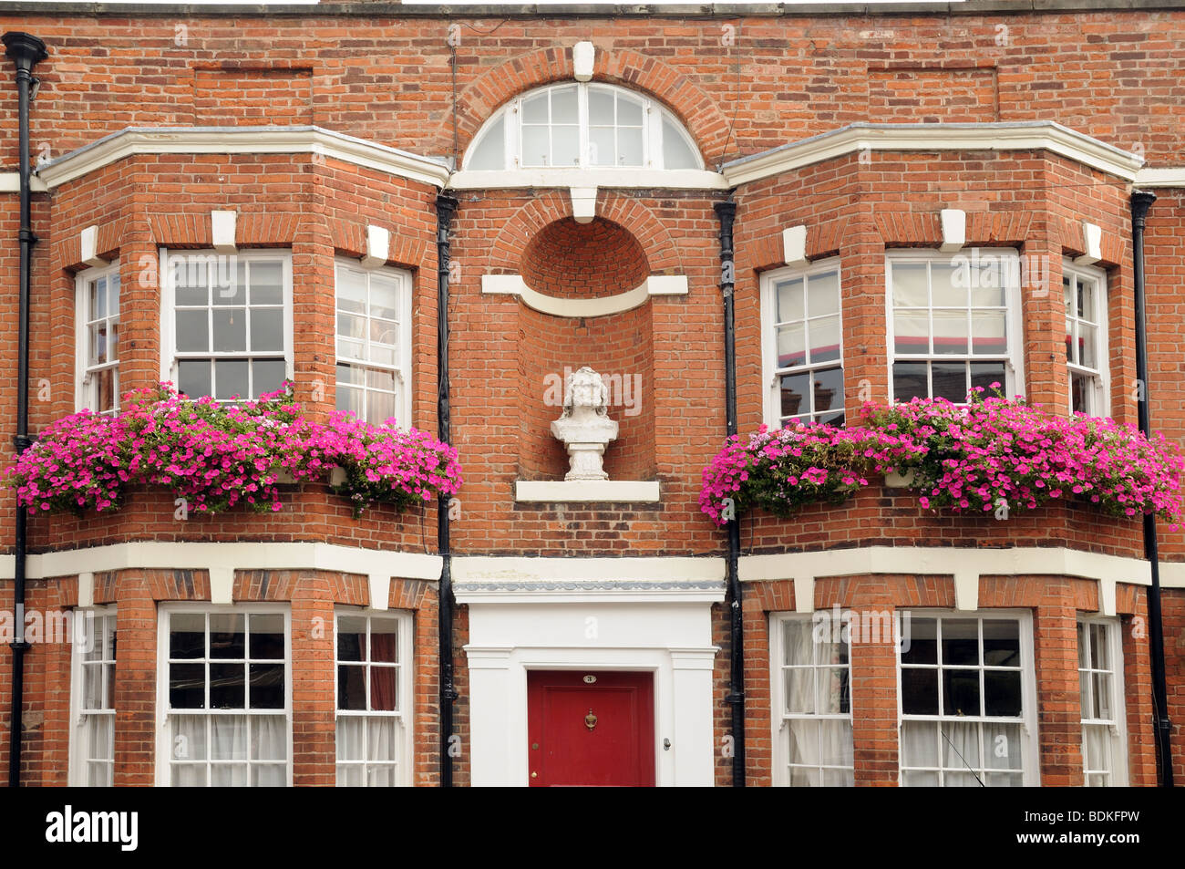 Fine Old Red Brick Built House With Bay Windows And Window Boxes Of