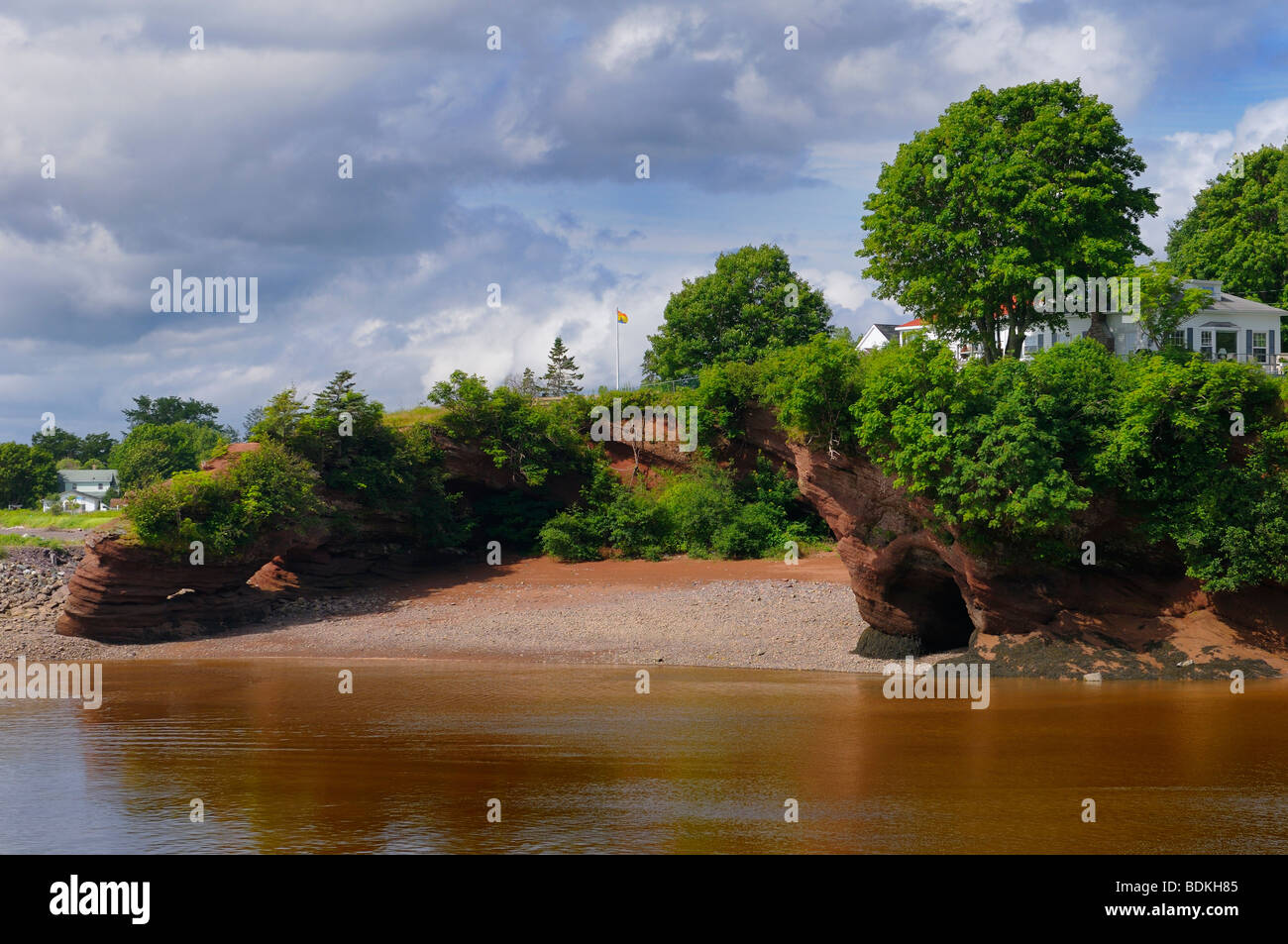House over the sea caves and arches on the shores of St Martins Bay of Fundy New Brunswick - Stock Image