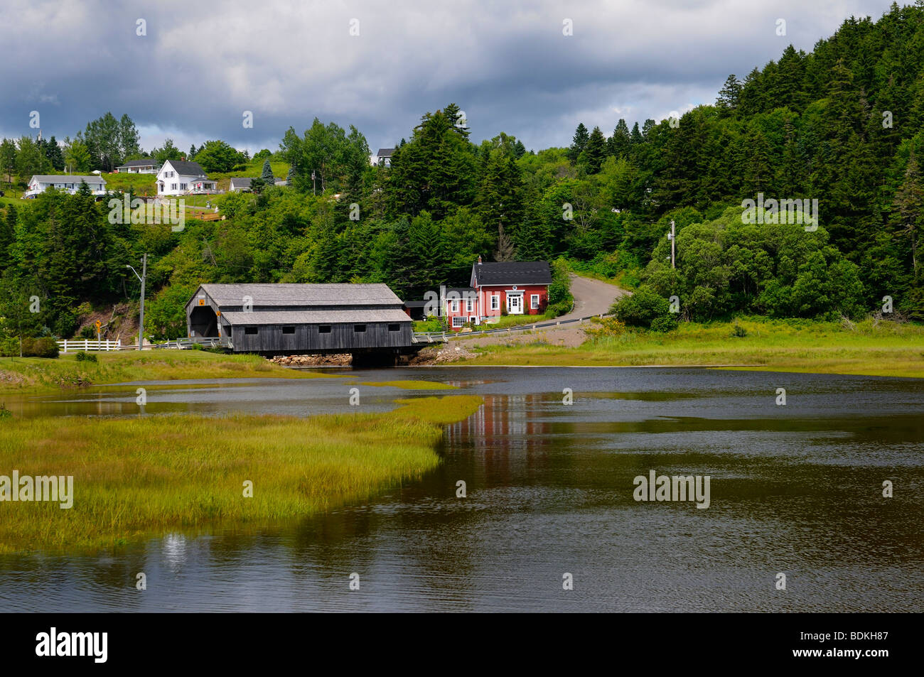 Covered bridge over the Irish River in St Martins, Bay of Fundy, New Brunswick, Canada - Stock Image