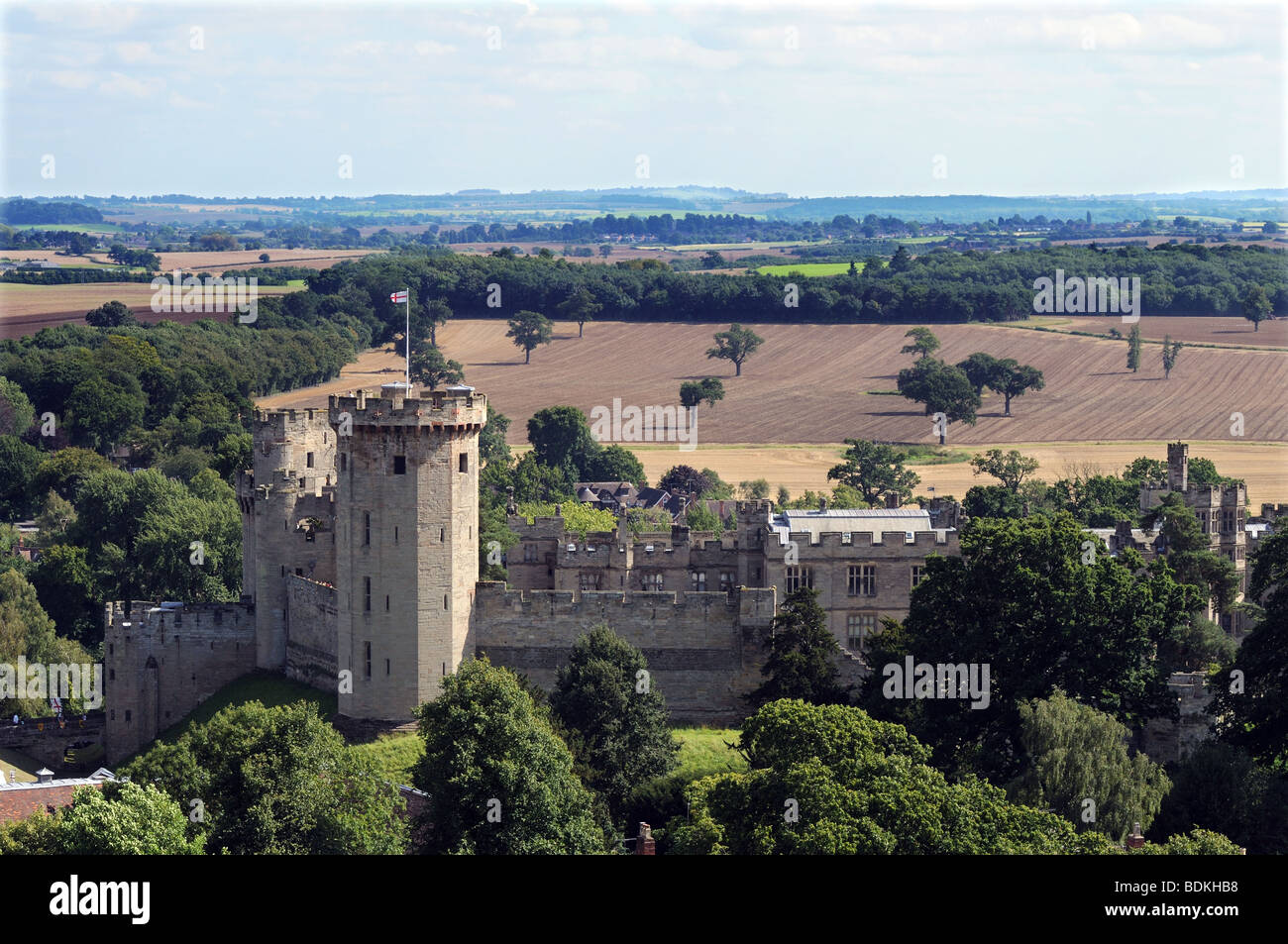 Warwick Castle tower and fortifications from top of tower of St Mary's Church Warwick England - Stock Image