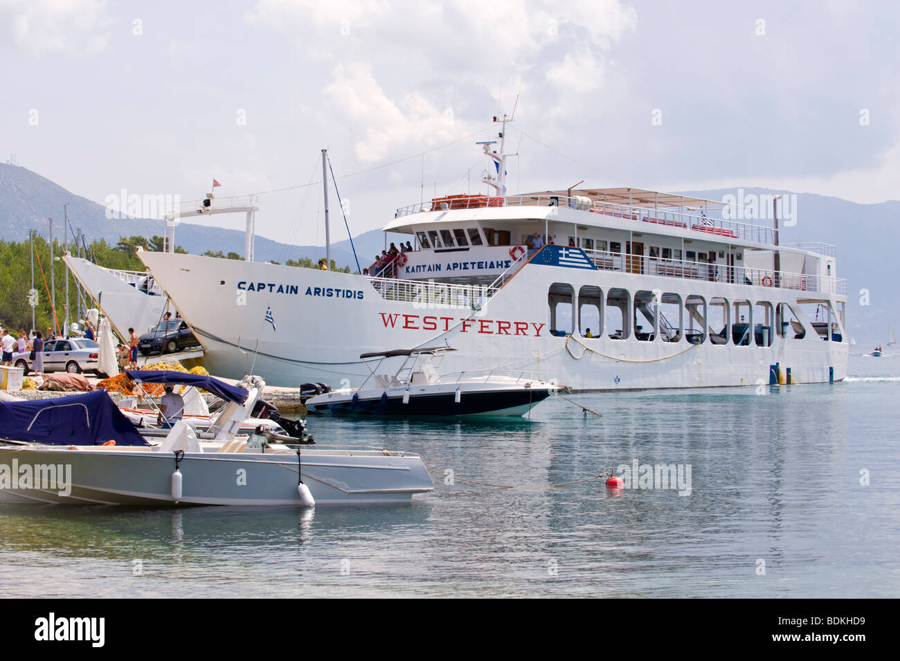 Passenger and car ferry disembarking in harbour at Fiskardo on the Greek Mediterranean island of Kefalonia Greece - Stock Image