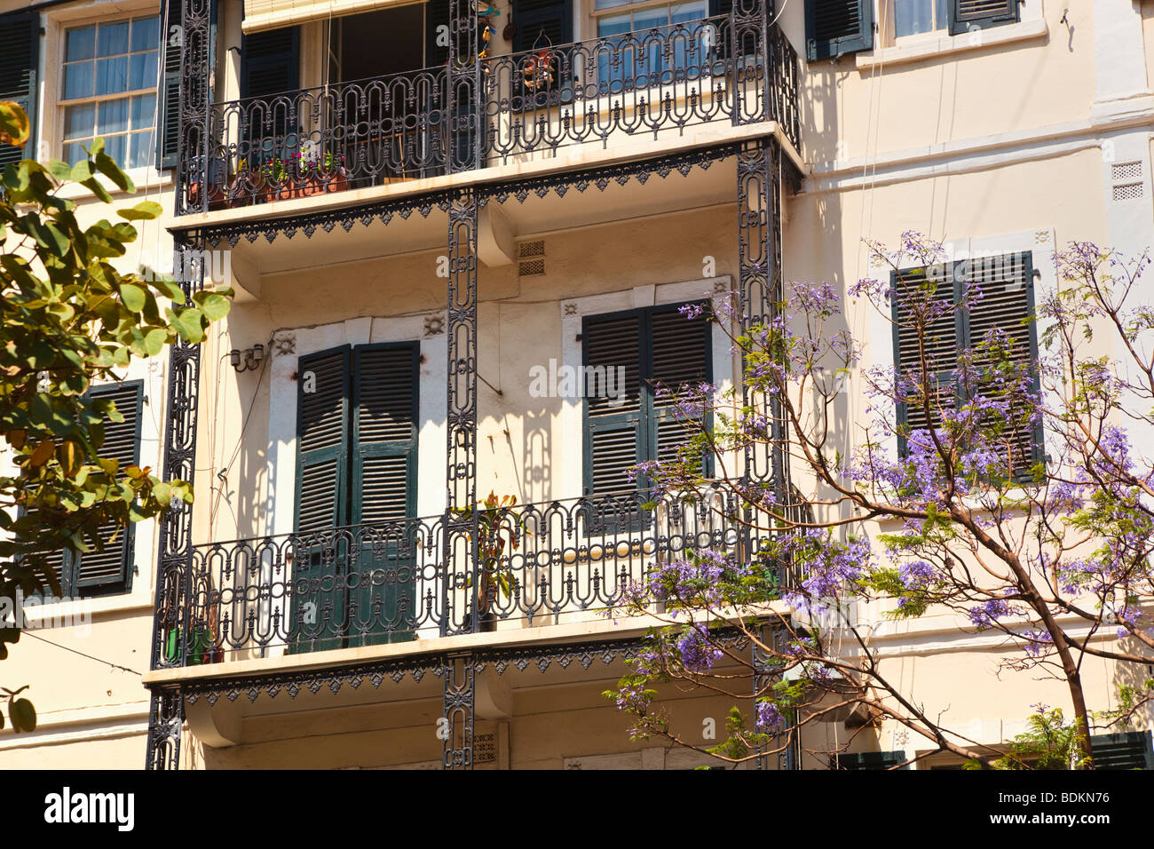 Gibraltar.  Typical architecture in Main Street. Wrought iron balconies, sash windows and Mediterranean style shutters. - Stock Image