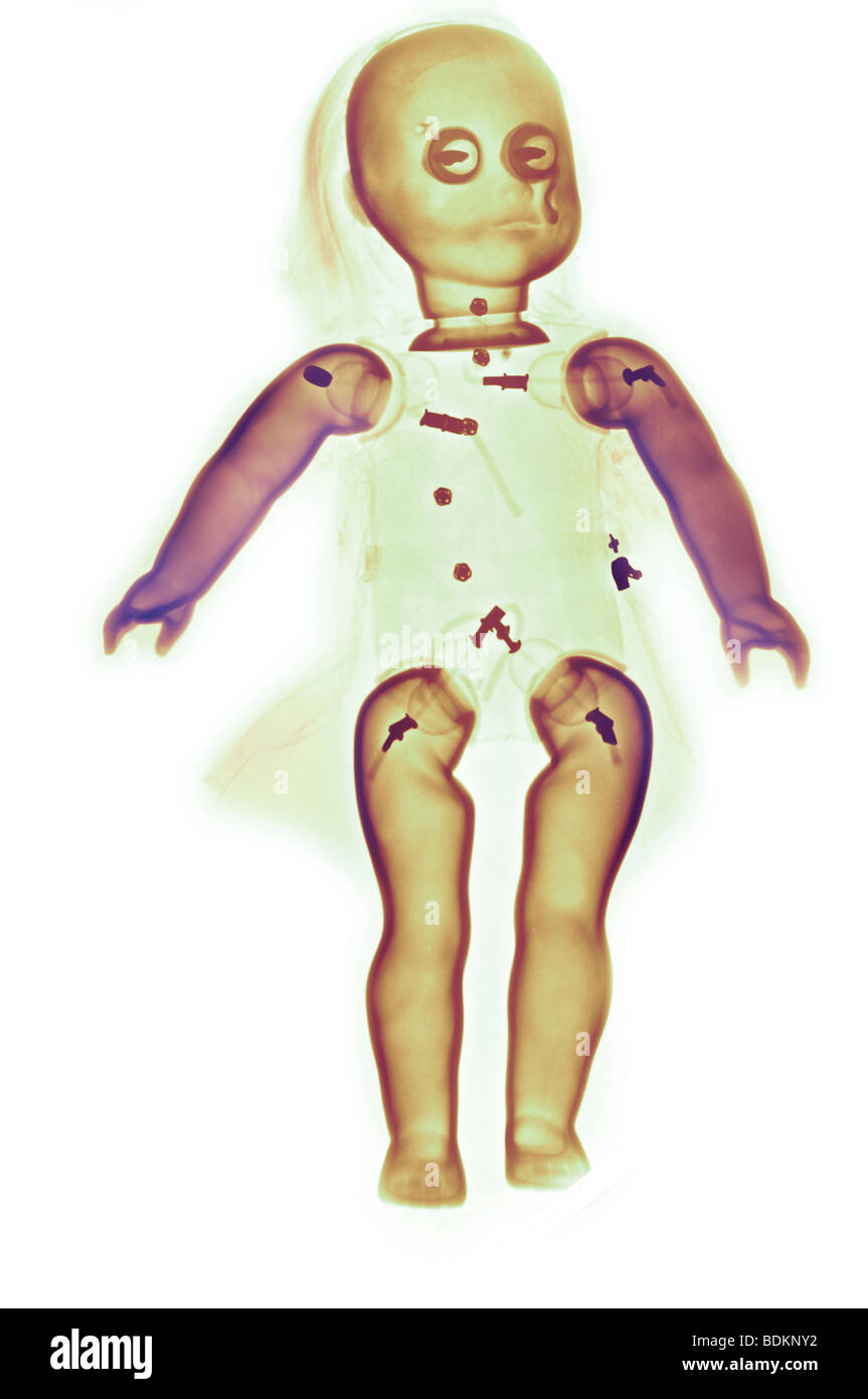 color enhanced x-ray of a doll - Stock Image