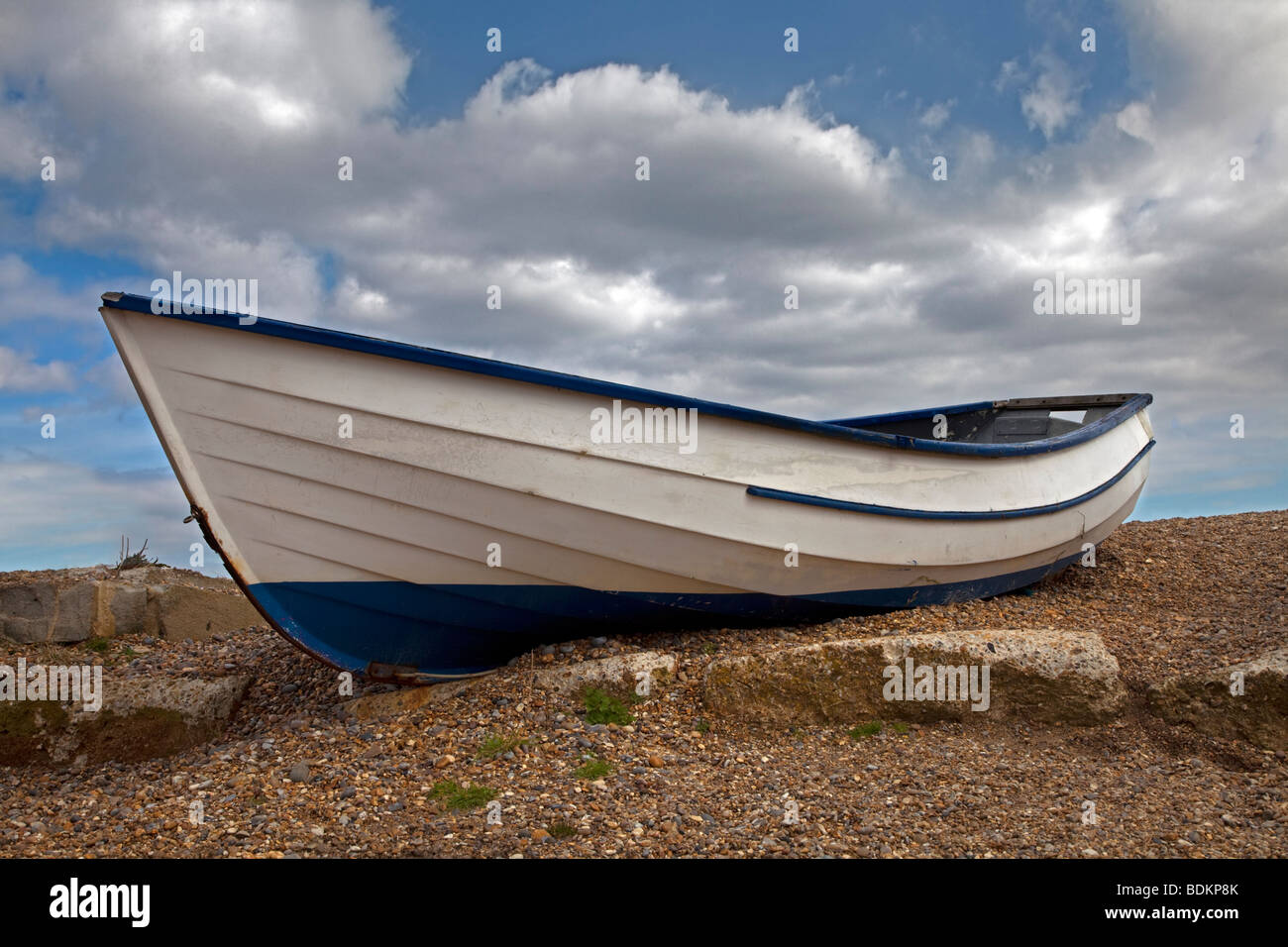 White Rowing Boat on Beach, Suffolk - Stock Image