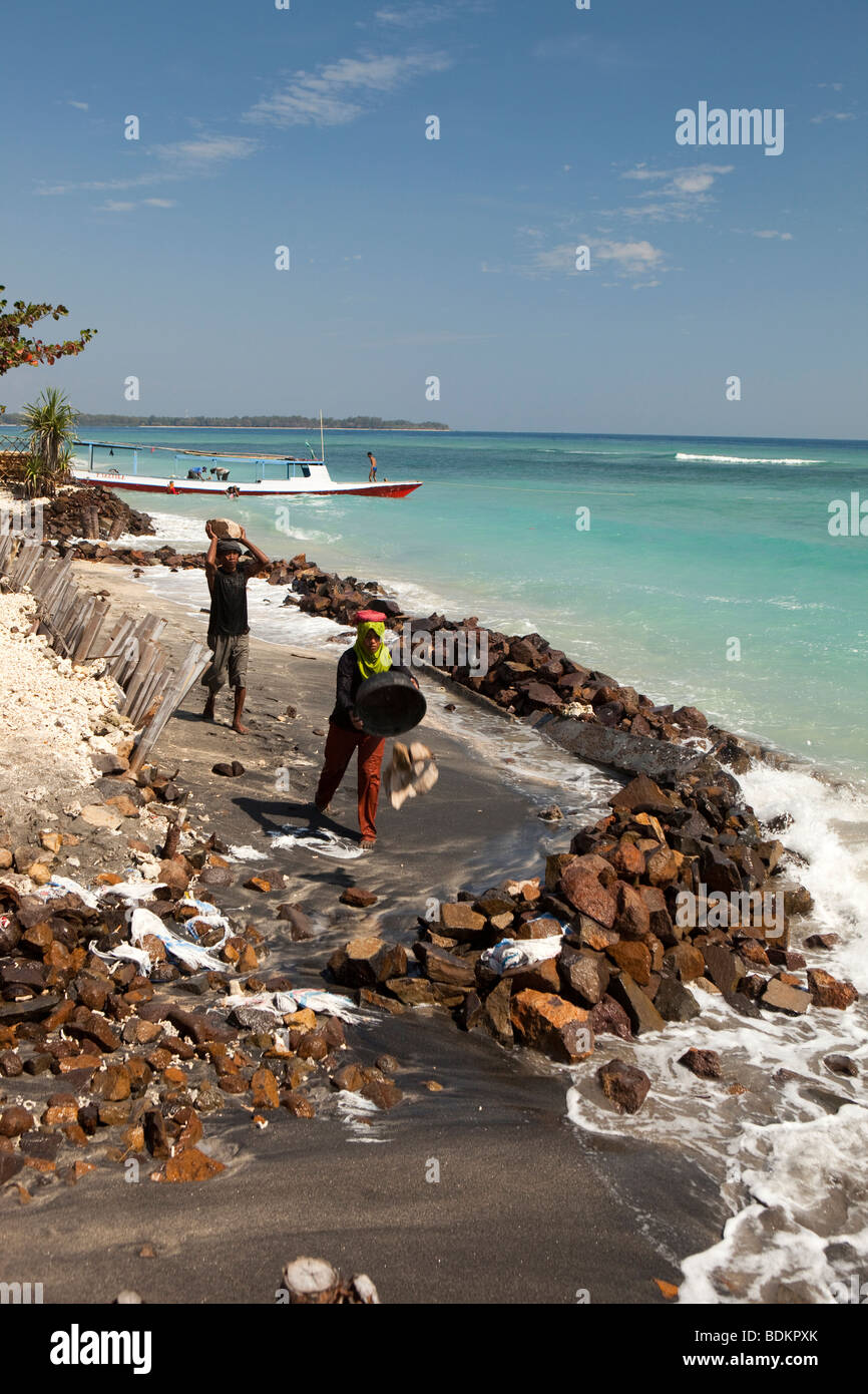 Indonesia, Lombok, Gili Air, environment, shoring up beach with rocks against coastal erosion - Stock Image