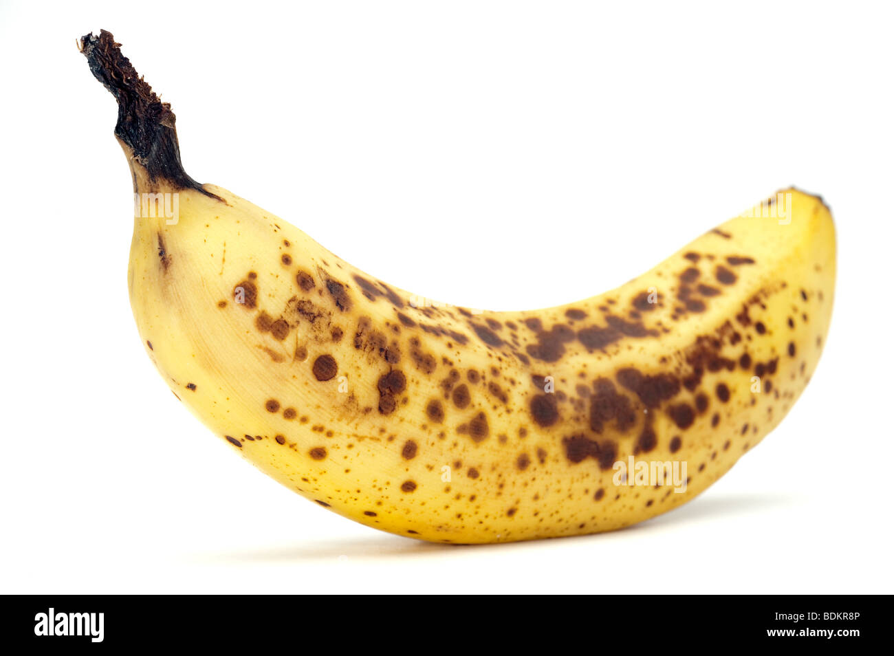 'Over ripe' speckled banana - Stock Image