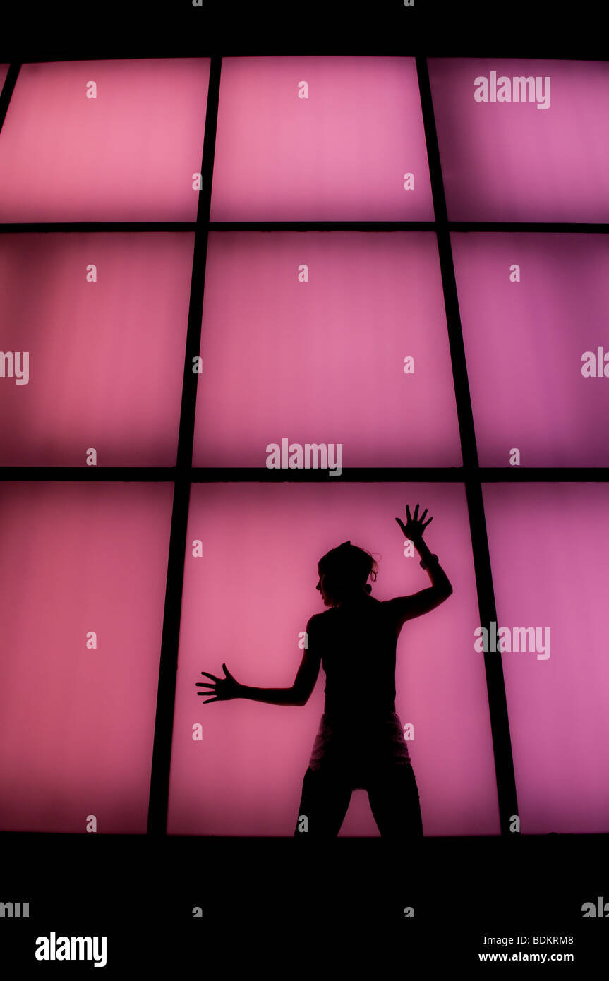 Neon Dancer silhouette - Stock Image