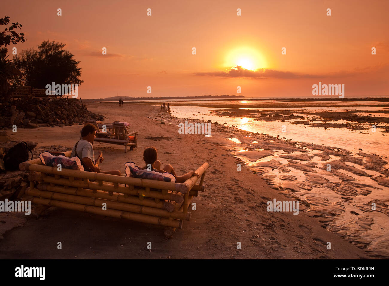 Indonesia, Lombok, Gili Air, north coast, sunset point, people enjoying setting sun playing guitar - Stock Image
