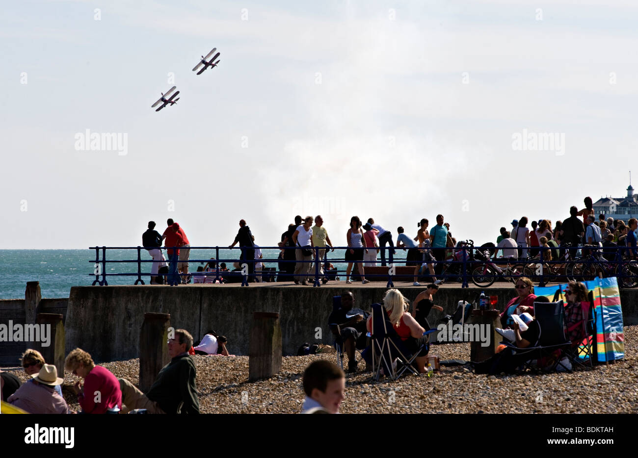 Two biplanes perform for the beach crowds at the Eastbourne airshow, England. - Stock Image