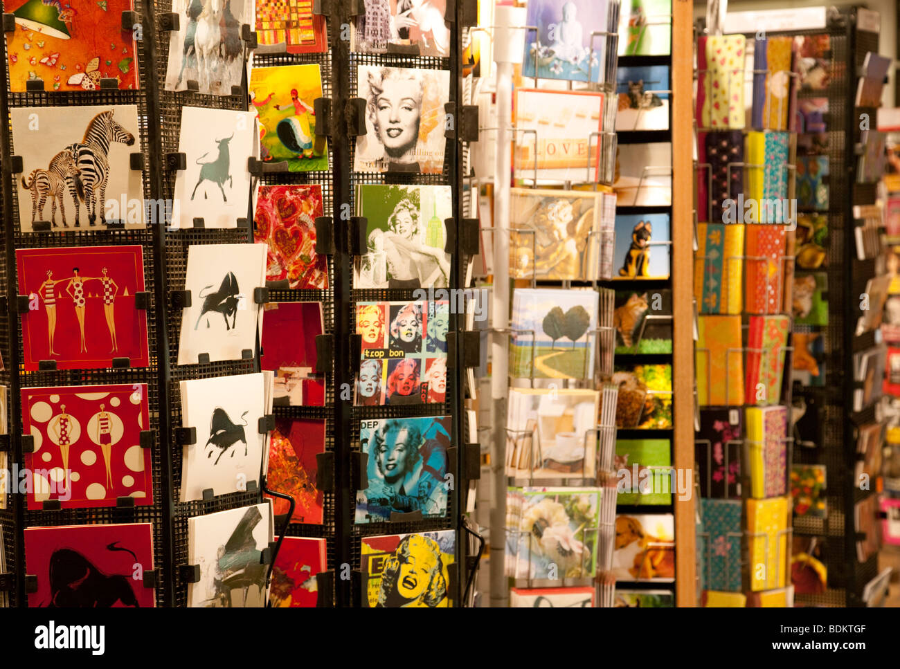 Colourful postcards for sale in Paris France - Stock Image