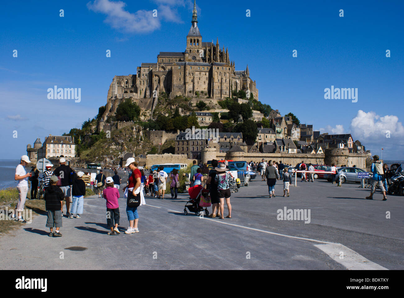 Tourists at Mont Saint-Michel, the monastery and village on a tidal island between Brittany and Normandy - Stock Image