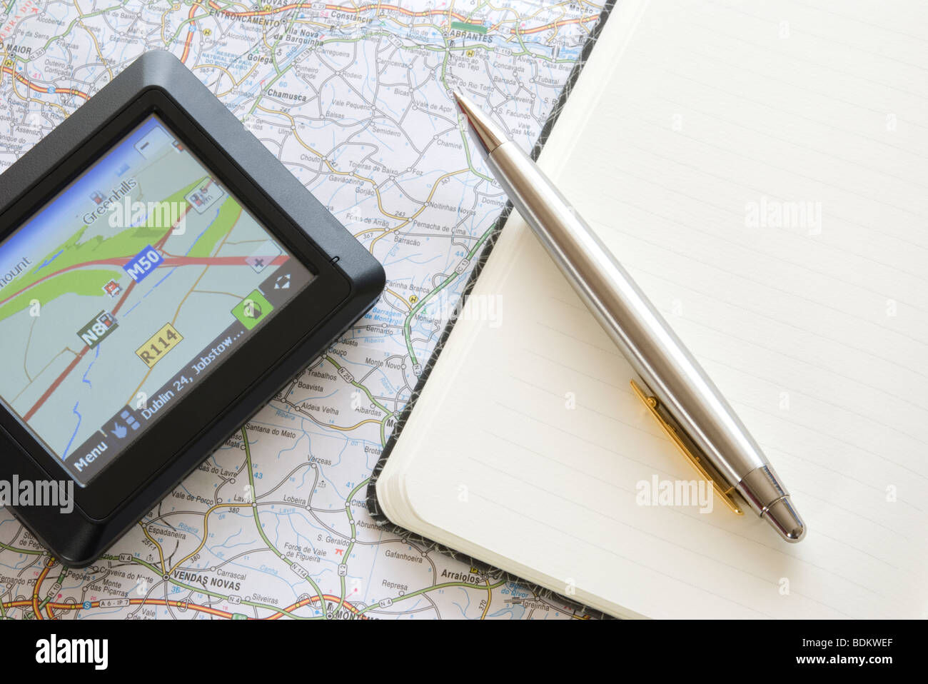 GPS global positioning system device arranged with map - Stock Image