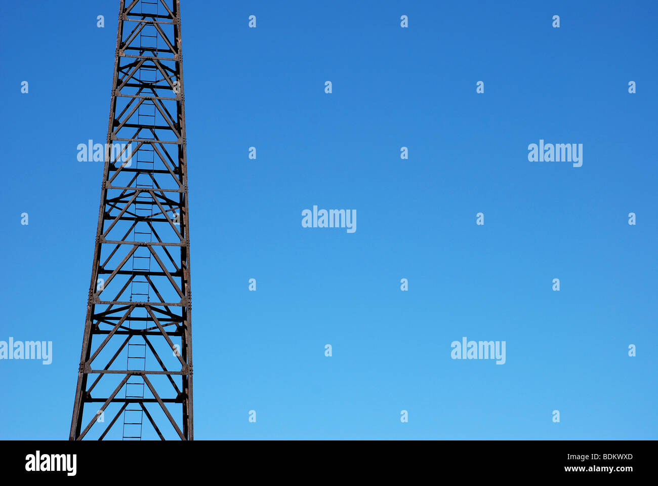 Metal, light tower on a pier at the shore of Lake Michigan, Chicago, IL, USA - Stock Image