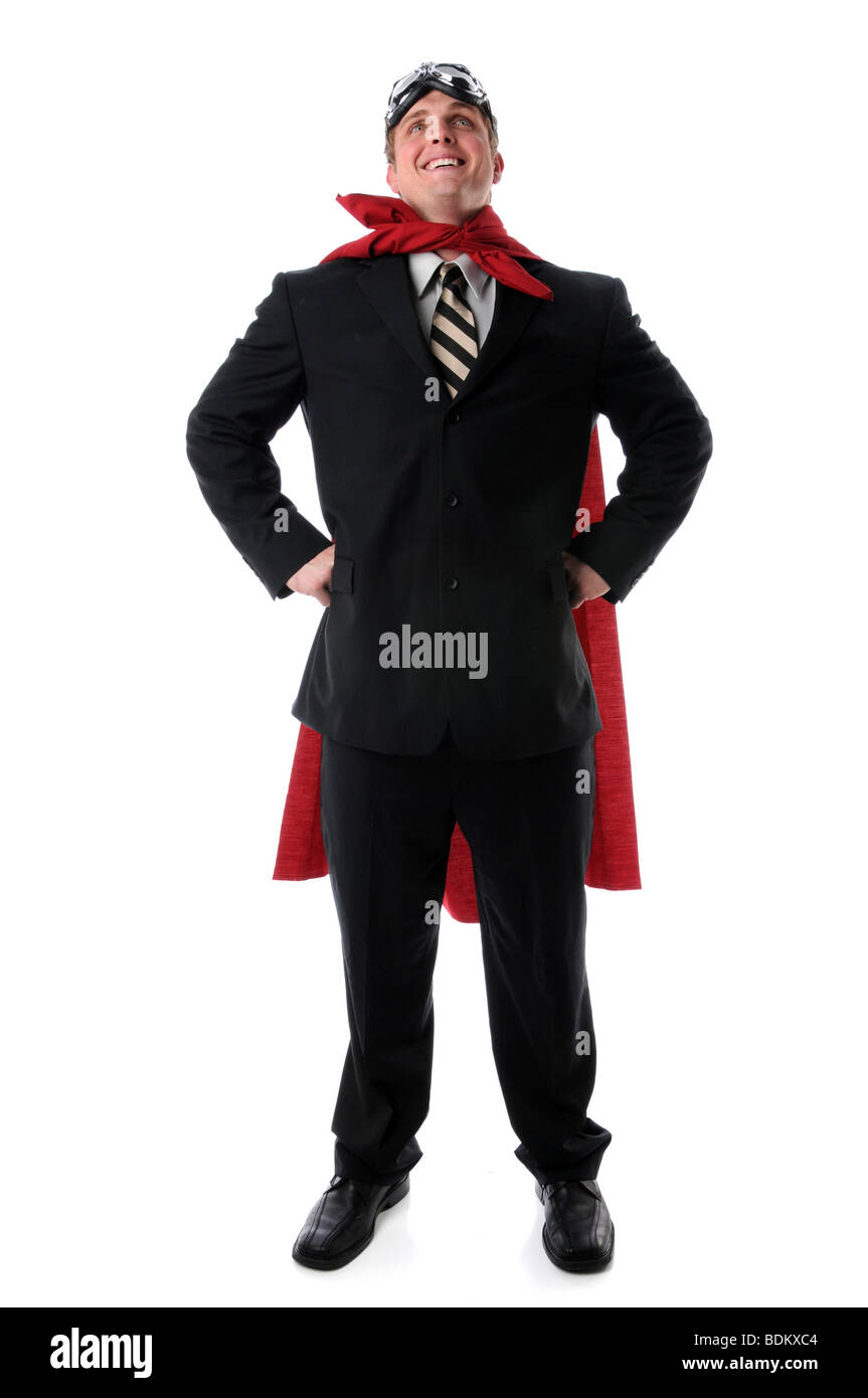 Super businessman with cape and goggles smiling confidently - Stock Image