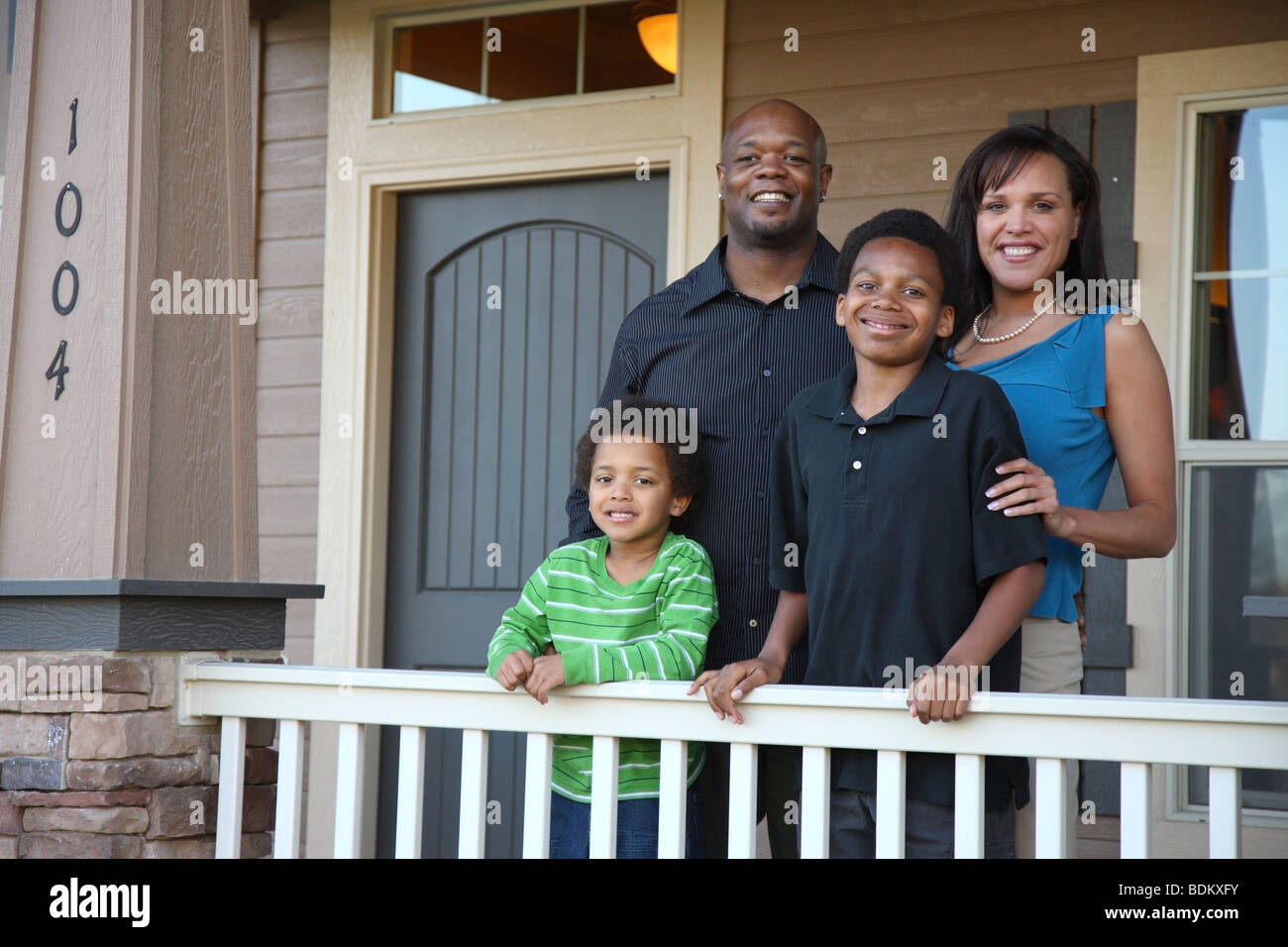 African American family on porch - Stock Image