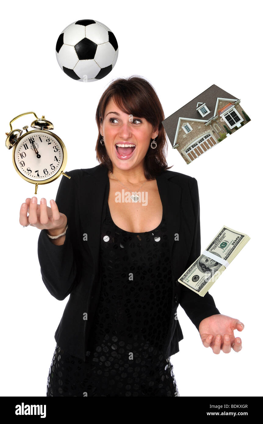 Businesswoman juggling responsibilities - Stock Image
