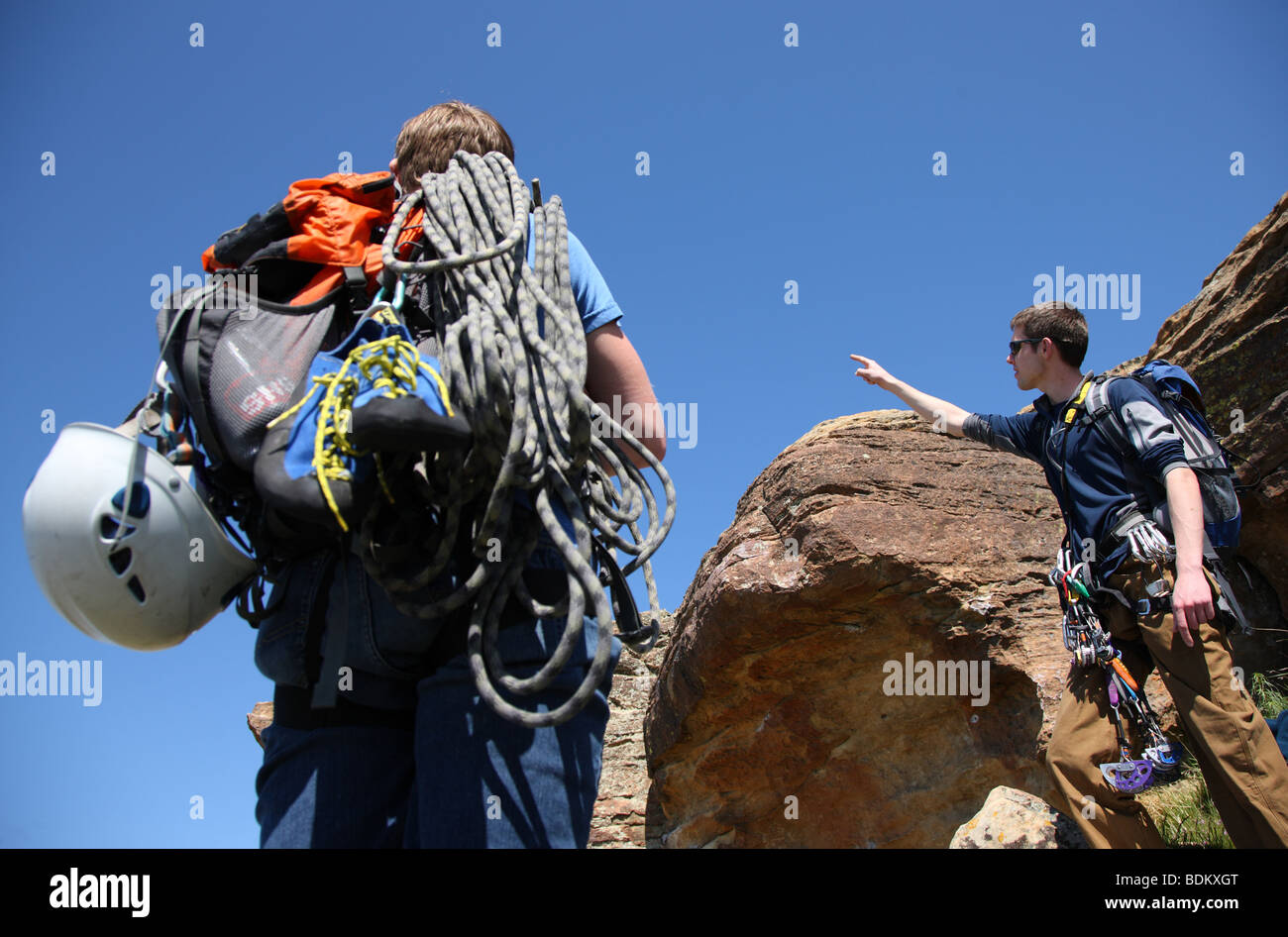 Two rock climbers gear up for climb - Stock Image