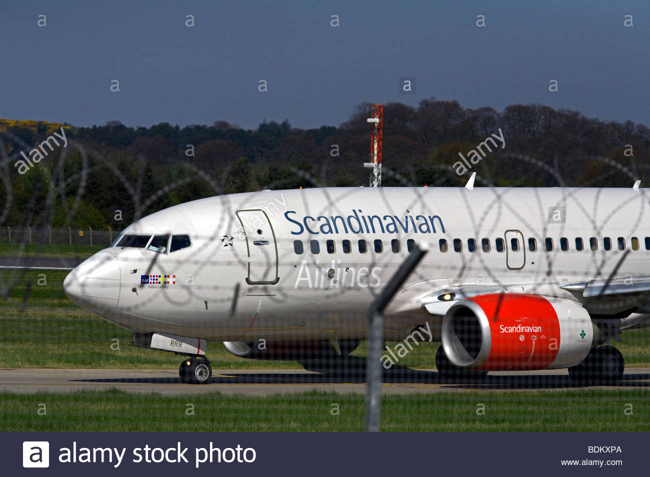 Scandinavian Airlines flight taxiing at airport - Stock Image