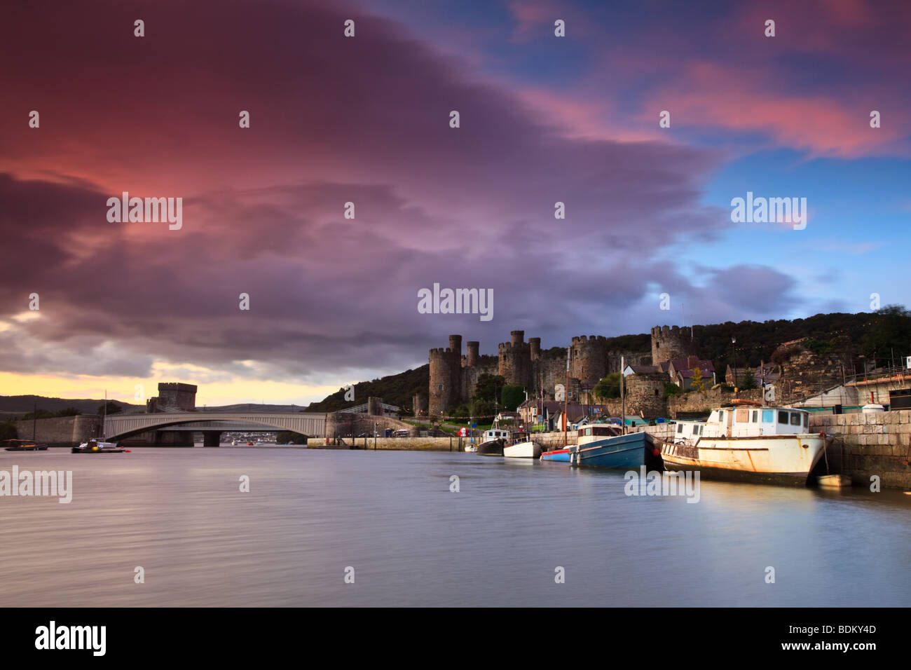 Early morning sunrise over Conwy castle in North Wales. - Stock Image