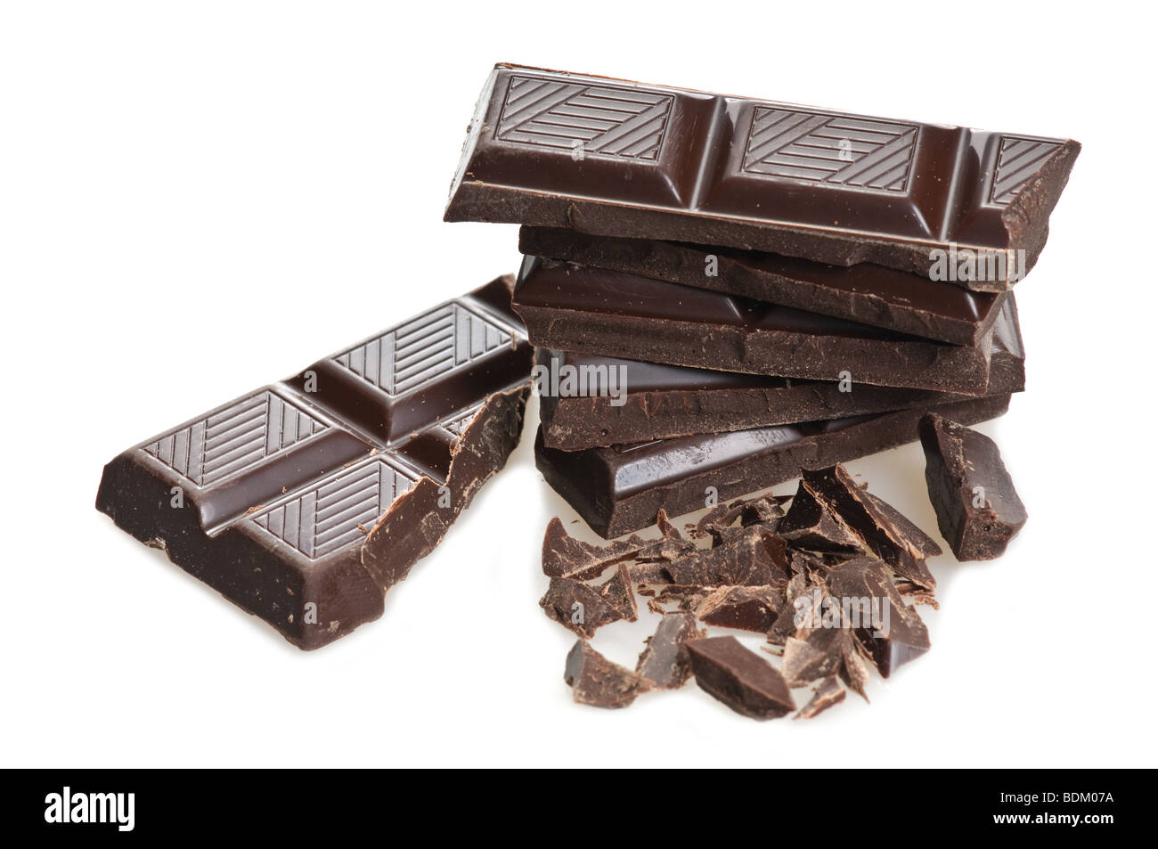 broken chocolate over white background with copy space - Stock Image