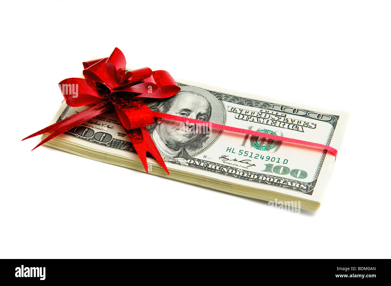 Money tied red ribbon isolated on white - Stock Image