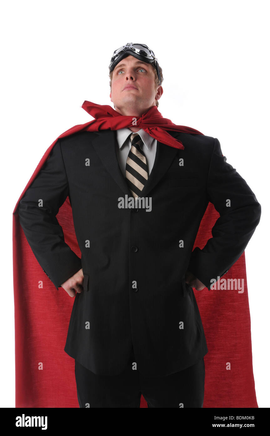 Businessman hearing a cape and goggles representing a business super hero - Stock Image