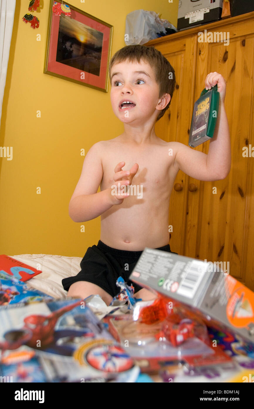 Young Boy Opening Birthday Presents