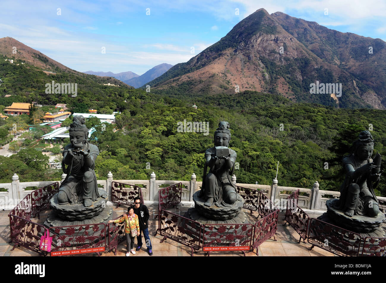 The Offering of the Six Devas: Buddhistic statues praising and making offerings to the Tian Tan Buddha. Po Lin Monastery - Stock Image