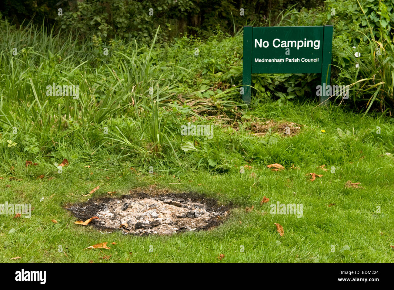 burn mark on caused by fire damage on grass in Chilterns countryside  near Hambleden, Buckinghamshire, UK - Stock Image